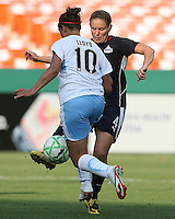 Cat Whitehill #4 of the Washington Freedom passes the ball through Carli Lloyd #10 of the Chicago Red Stars during a WPS match at RFK stadium on June 13 2009 in Washington D.C. The game ended in a 0-0 tie.