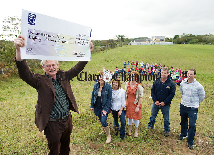 Pat Mc Namara, Principal of Knockanean N.S. accepting a cheque to the value of €80,000 from members of the fundraising committee; Caroline Purcell, Kellie Kennedy and Mary Mc Govern watched by John Corbett and Colm Forde, teachers. Photograph by John Kelly.