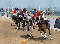 Jamie Le Hardie of Wales in action under pressure from Tito Gaudenzi of England during the Wales v England match at the Asahi Beach Polo Championship  at Sandbanks, Poole, England on 10 July 2015. Photo by Andy Rowland.