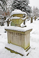 Snow covered monument of Hugh Gaitskell's grave, Hampstead Parish churchyard, London, UK