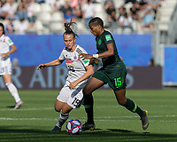 GRENOBLE, FRANCE - JUNE 22: Rasheedat Ajibade #15 dribbles as Klara Buehl #19 defends during a game between Panama and Guyana at Stade des Alpes on June 22, 2019 in Grenoble, France.