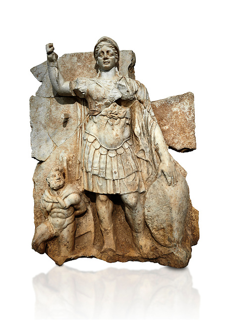 Roman Sebastian relief  sculpture of Roma armed, Aphrodisias Museum, Aphrodisias, Turkey.   Against a white background.<br /> <br /> Roma is equipped with a spear, helmet, round shield and imperial style armour. Blow crouches a naked bearded prisoner, with hands tied behind his back and a skin knotted around his neck. He turns to look up at Roma