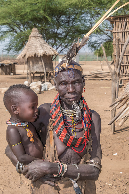 This Karo matriarch and grandchild exemplify  the short life span between childhood and old age- approximately 45 years.