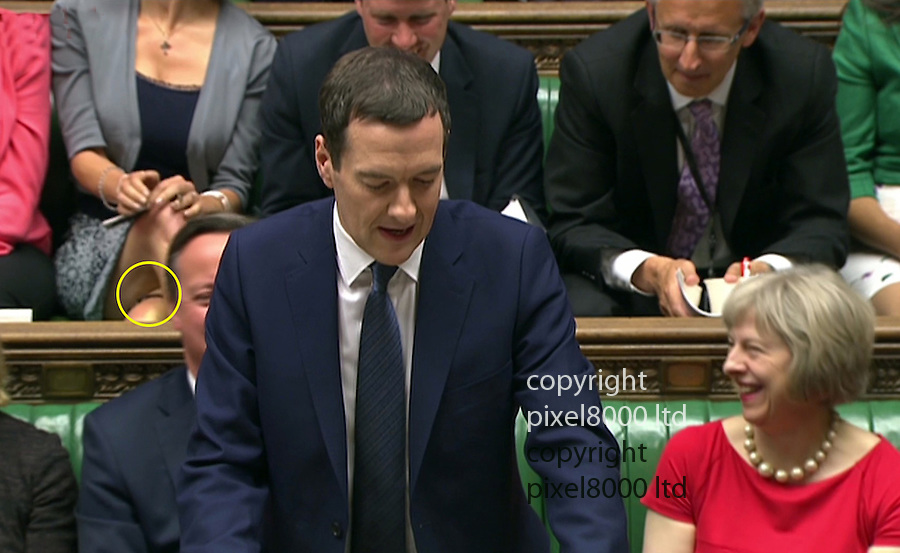 "Pic shows: Budget 2015 -<br /> <br /> Charlotte Leslie MP sitting behind David Cameron had Twitter astir as she kept wriggling in her seat - many thinking she was ""busting for the loo""<br /> <br /> She also crossed her legs revealing a strap that could be a garter.<br /> <br /> She also yanked up her low cut top after revealing a little to much cleavage<br /> <br /> <br /> Picture by Pixel8000 07917221968"