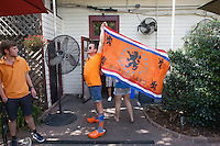 New Orleans, LA - Saturday, July 5, 2014: A Holland fan shows off his pride while Dutch fans watch the Netherlands vs. Costa Rica World Cup quarterfinal match at the Rusty Nail.