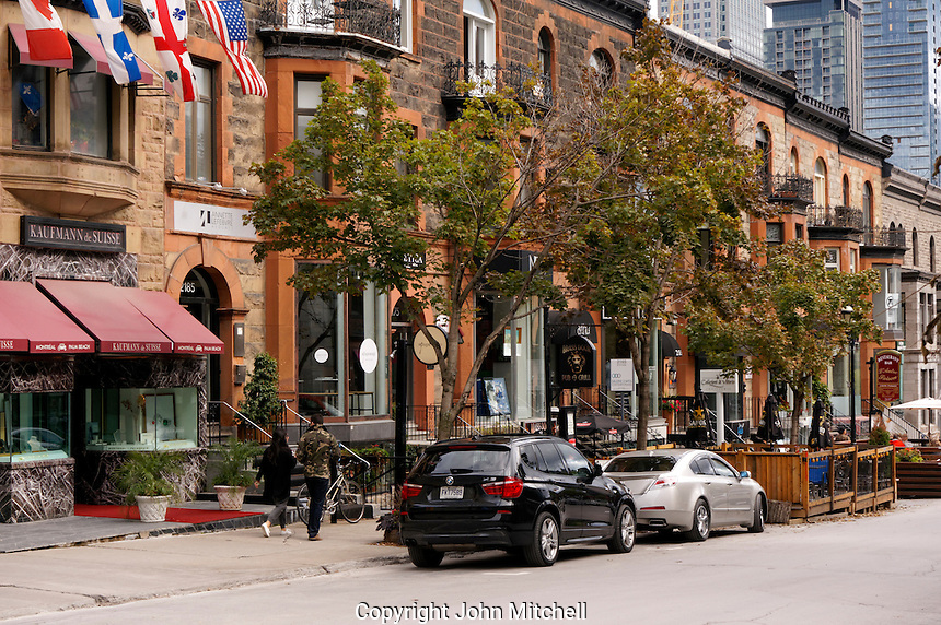 Man and woman walking down Crescent Street in downtown Montreal, Quebec, Canada