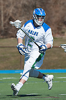 Frank Russo,'16, defends as the Seahawks battle Endicott in Men's Lacrosse game action at Gaudet Field in Middletown.