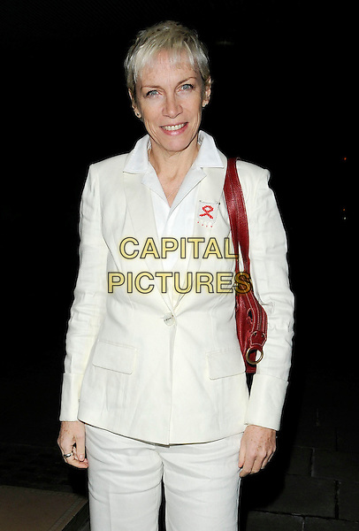 ANNIE LENNOX.The White Ribbon Alliance's Global Dinner Party Campaign VIP Event,  Sanderson Hotel, London, England, UK, March 4th 2010..half length white cream shirt jacket trousers trouser suit  red bag shoulder .CAP/CAN.©Can Nguyen/Capital Pictures.