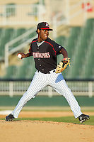 Kannapolis Intimidators relief pitcher Euclides Leyer (26) in action against the Rome Braves at CMC-Northeast Stadium on August 25, 2013 in Kannapolis, North Carolina.  The Intimidators defeated the Braves 9-0.  (Brian Westerholt/Four Seam Images)