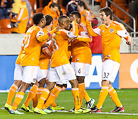 Dynamo players celebrate after Ricardo Clark scores a goal in the second half at BBVA Compass Stadium. Houston beat D.C United, 2-0 in the MLS season opener.