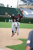 August 8, 2009:  Trey Griffin and Zach Alvord of the Baseball Factory team celebrate after winning the Under Armour All-America game at Wrigley Field in Chicago, Illinois.  (Copyright Mike Janes Photography)