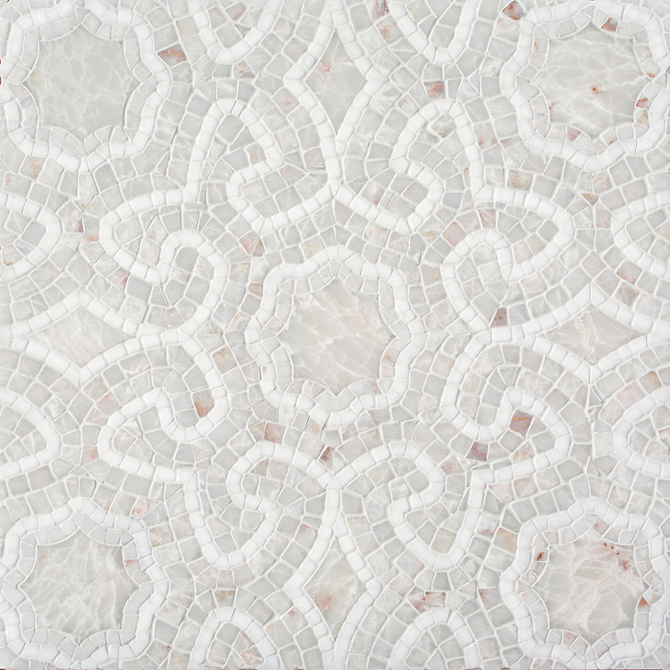 Juliana, a stone waterjet and hand-cut stone mosaic, shown in honed and hand-chopped tumbled Heavenly Cream and hand-chopped tumbled Thassos, is part of the Miraflores Collection by Paul Schatz for New Ravenna.