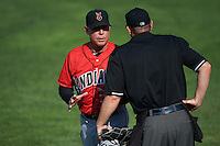 Indianapolis Indians manager Dean Treanor (27) argues a call with umpire Max Guyll during a game against the Rochester Red Wings on June 10, 2015 at Frontier Field in Rochester, New York.  Indianapolis defeated Rochester 5-3.  (Mike Janes/Four Seam Images)