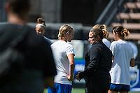 Seattle, Washington - Sunday, June 12, 2016: Seattle Reign FC head coach Laura Harvey chats with Seattle Reign FC forward Merritt Mathias (9) prior to a regular season National Women's Soccer League (NWSL) match at Memorial Stadium. Seattle won 1-0.