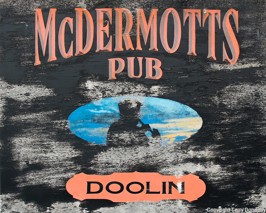 County Clare, Ireland:<br /> Weathered pub sign on a Doolin village street