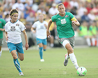 Abby Wambach #20 of Abby's XI races away from her Freedom teammate Sonia Bompastor #8 of Marta's XI during the WPS All-Star game at KSU Stadium in Kennesaw, Georgia on June 30 2010. Marta XI won 5-2.