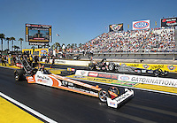 Mar. 16, 2013; Gainesville, FL, USA; NHRA top fuel dragster driver Clay Millican (near) races alongside teammate Bob Vandergriff Jr during qualifying for the Gatornationals at Auto-Plus Raceway at Gainesville. Mandatory Credit: Mark J. Rebilas-