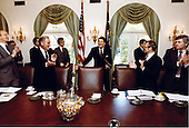 United States President Ronald Reagan attends his first cabinet meeting after the assassination attempt as Al Haig, James Watt, and Frank Carlucci applaud in the Cabinet Room in the White House in Washington, D.C. on Friday, April 24, 1981. .Mandatory Credit: Michael Evans - White House via CNP