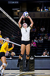 Rachel Burau (11) of the Wake Forest Demon Deacons sets the ball during the match against the Loyola Ramblers in the LJVM Coliseum on September 3, 2016 in Winston-Salem, North Carolina.  The Ramblers defeated the Demon Deacons 3-2.   (Brian Westerholt/Sports On Film)