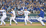 Royals team group,<br /> SEPTEMBER 30, 2014 - MLB :<br /> Salvador Perez (L) of the Kansas City Royals celebrates with his teammates Erik Kratz #19, Eric Hosmer #35 and Norichika Aoki #23 after hitting the game winning RBI single in the bottom of the 12th inning during the American League Wild Card playoff baseball game against the Oakland Athletics at Kauffman Stadium in Kansas City, Missouri, United States. (Photo by AFLO)