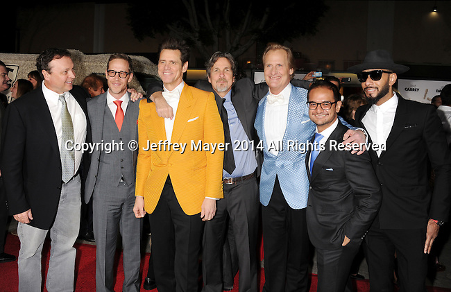 WESTWOOD, CA - NOVEMBER 03: (L-R) Directors Bobby Farrelly, producer Joey McFarland, actor Jim Carrey, filmmaker Peter Farrelly, actor Jeff Daniels, producer Riza Aziz and musician Swizz Beatz arrive at the Los Angeles premiere of 'Dumb And Dumber To' at Regency Village Theatre on November 3, 2014 in Westwood, California.