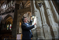 BNPS.co.uk (01202 558833)<br /> Pic: PhilYeomans/BNPS<br /> <br /> Graffiti guide Steve Dunn hunts out some of the less profound iconography in the ancient cathedral.<br /> <br /> Salisbury Cathedral has taken the unusual step of launching 'Grafitti Tours' of it's 800 year old building, as part of a three year project to document the thousands of examples of centuries-old 'graffiti' which adorn the walls of the 13th century cathedral.<br /> <br /> The inside of the Cathedral in Wiltshire is covered in markings etched into its fabric by fervent, desperate or just bored visitors ranging from simple inscriptions to more intricate designs used to ward off evil spirits.  <br /> <br /> Cathedral guide Steve Dunn intends to record all the marks or 'graffiti' which in some cases date back from when the cathedral was completed in 1258.<br /> <br /> Helped by about 60 volunteers, he is collating images of the graffiti and researching the story behind them.