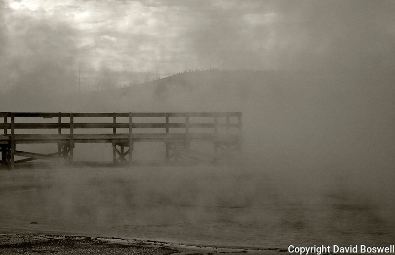 The boardwalk at Black Sands Basin, Yellowstone National Park, as it extends over Sunset Lake.