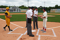 Birmingham Barons coach Michael Johnson (5) shakes hands with umpire James Rackley during the lineup exchange as Dave Berg (12) walks in before the 20th Annual Rickwood Classic Game against the Jacksonville Suns on May 27, 2015 at Rickwood Field in Birmingham, Alabama.  Jacksonville defeated Birmingham by the score of 8-2 at the countries oldest ballpark, Rickwood opened in 1910 and has been most notably the home of the Birmingham Barons of the Southern League and Birmingham Black Barons of the Negro League.  (Mike Janes/Four Seam Images)