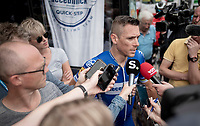 Philippe Gilbert (BEL/Deceuninck-Quickstep) giving an impromptu press conference at the teambus jus before the race, after just having received the news he was not selected to participate in the upcoming Tour de France (starting in Brussels 10 days later)<br /> <br /> 72nd Halle - Ingooigem 2019 (BEL/1.1)<br /> 1 day race from Halle to Ingooigem (201km)<br /> <br /> ©kramon