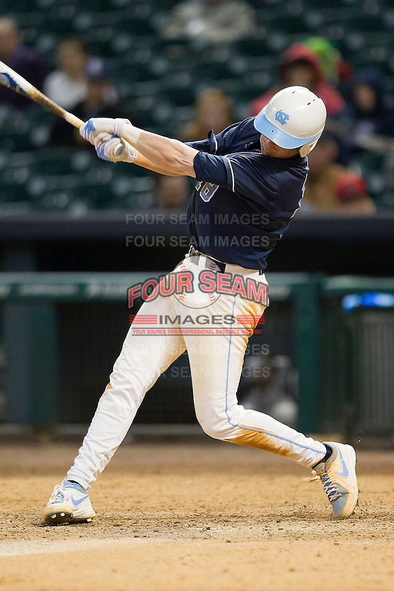 North Carolina Tar Heels third baseman Colin Moran #18 swings during the NCAA baseball game against the Rice Owls on March 1st, 2013 at Minute Maid Park in Houston, Texas. North Carolina defeated Rice 2-1. (Andrew Woolley/Four Seam Images).