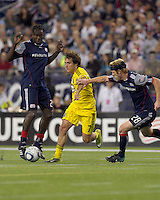 Columbus Crew forward Guillermo Barros Schelotto (7) starts to dribble as New England Revolution midfielder Pat Phelan (28) defends. The New England Revolution tied Columbus Crew, 2-2, at Gillette Stadium on September 25, 2010.