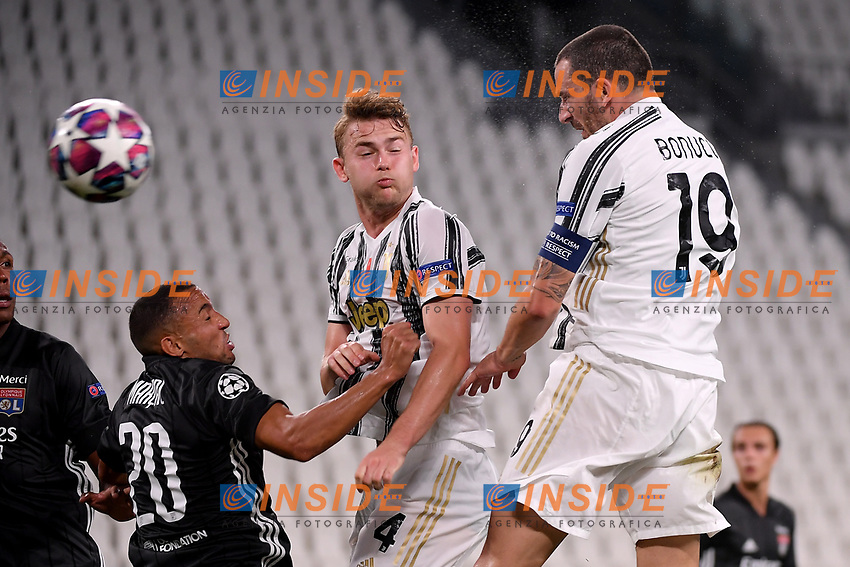 Fernando Marcal of Lyon, Matthijs de Ligt and Leonardo Bonucci of Juventus in action during the Champions League round of 16 second leg football match between Juventus FC and Lyon at Juventus stadium in Turin (Italy), August 7th, 2020. <br /> Photo Federico Tardito / Insidefoto