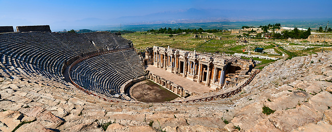 Picture of A Roman Theatre reconstructed over an earlier Greek theatre under the reign of Hadrian after the earthquake of 60 AD. The facade is 300 feet (91m) long, the full extent of which remains standingand the cavea has 50 rows of seats. Hierapolis archaeological site near Pamukkale in Turkey.