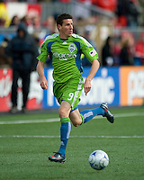 Sebastien LeToux of the Seattle Sounders FC takes a ball up field during action against Toronto at BMO Field in Toronto on April 4, 2009. Seattle won 2-0. Photo by Nick Turchiaro/isiphotos.com.