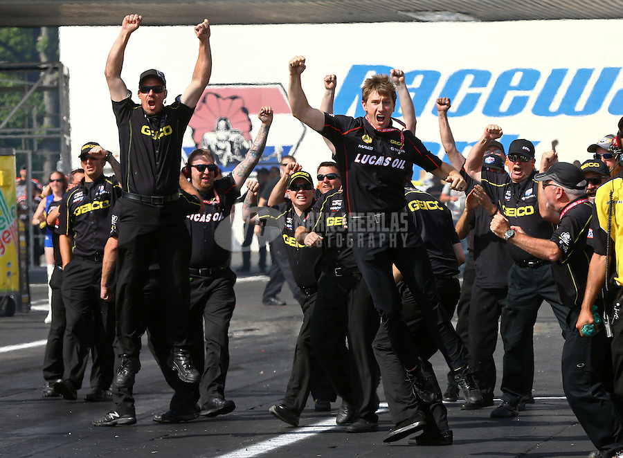June 1, 2014; Englishtown, NJ, USA; Team owner Morgan Lucas and crew members celebrates the victory by NHRA top fuel driver Richie Crampton (not pictured) during the Summernationals at Raceway Park. Mandatory Credit: Mark J. Rebilas-