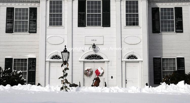 WOODBURY CT, 09 FEB 13-020913AJ05- Mike Sibilia shovels the steps at North Congregational Church on Main Street in Woodbury Saturday morning.     Alec Johnson/ Republican-American
