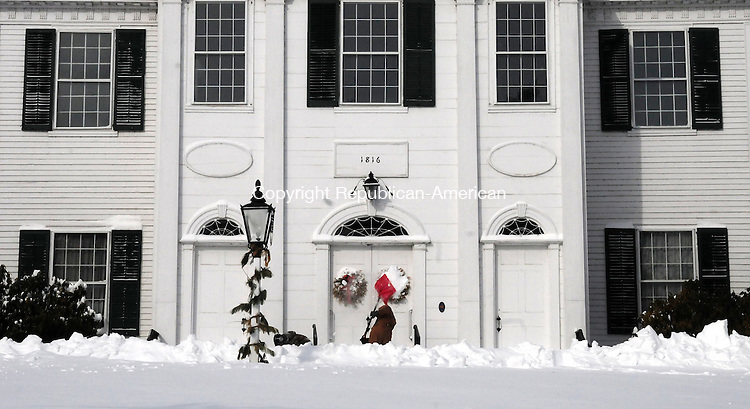 WOODBURY CT, 09 FEB 13-020913AJ05- Mike Sibilia shovels the steps at North Congregational Church on Main Street in Woodbury Saturday morning.     Alec Johnson/ Republican-American