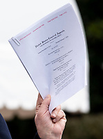 United States President Donald J. Trump holds documents related to his emoluments case against him as he speaks to the media while departing the White House for a day trip to Charlotte, North Carolina in Washington, D.C. on Friday, February 7, 2020. <br /> Credit: Kevin Dietsch / Pool via CNP/AdMedia