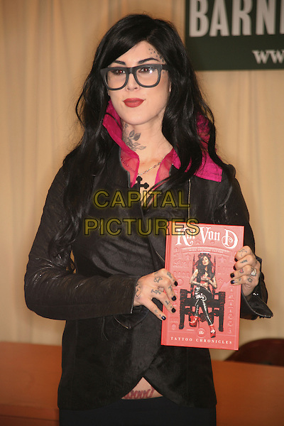 "KAT VON D.""The Tattoo Chronicles"" book signing at Barnes & Noble Fifth Avenue, New York, NY, USA, October 26th, 2010..half  length geek glasses black leather jacket leggings tattoos pink collar .CAP/LNC/TOM.©TOM/LNC/Capital Pictures."
