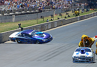 Jul, 22, 2012; Morrison, CO, USA: NHRA pro stock driver Paul Pittman (left) crashes alongside Allen Johnson during the Mile High Nationals at Bandimere Speedway. Pittman would be uninjured in the incident. Mandatory Credit: Mark J. Rebilas-