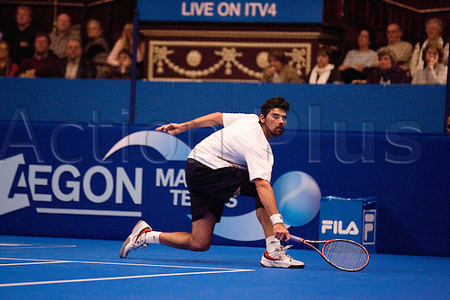 02 December 2009 - AEGON Masters Tennis, Royal Albert Hall, London. Mark Philippoussis aka The Scud v Greg Rusedski. Philippoussis hitting the ball. .This end-of-year tournament (1-6 December 2009) is the season finale to the ATP Champions Tour, a year-long tour that makes its way across Europe and the world and pits past tennis champions against each other in order to earn ranking points. Photo by Ingrid Abery/Actionplus. World Editorial Licenses.