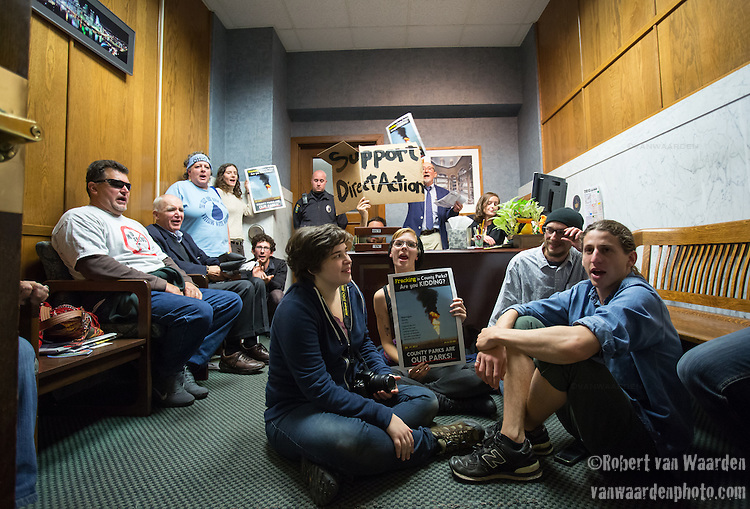 A group of concerned citizens and protestors stage a sit-in the office of Rich Fitgerald at the County Executive in protest of fracking in Pennsylvania parks.