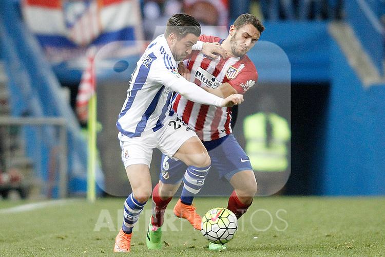 Atletico de Madrid's Koke Resurrecccion (r) and Real Sociedad's Hector Hernandez during La Liga match. March 1,2016. (ALTERPHOTOS/Acero)