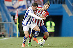 Atletico de Madrid's Koke Resurrecccion (r) and Real Sociedad's Hector Hernandez during La Liga match. March 1,2016. (ALTERPHOTOS/Acero)