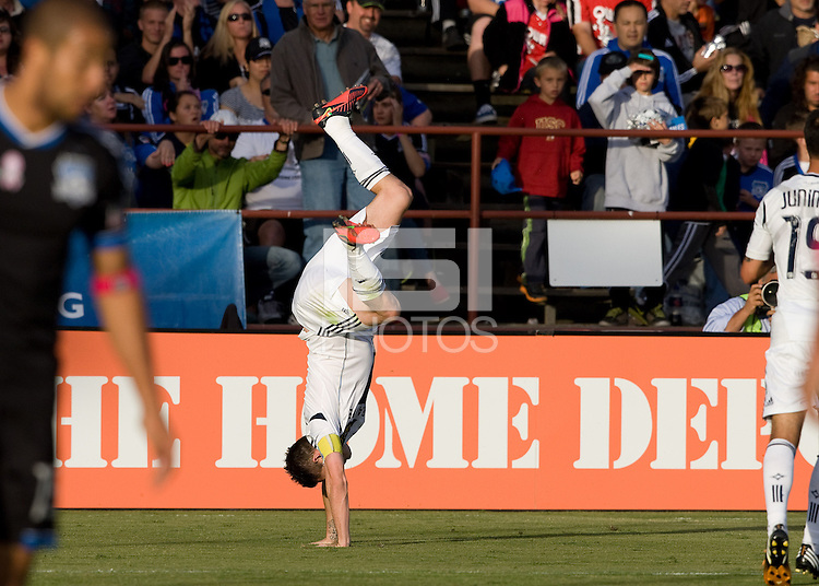 Robbie Keane of Galaxy side flips over after scoring a goal during the game against Earthquakes at Buck Shaw Stadium in Santa Clara, California on October 21st, 2012.  San Jose Earthquakes and Los Angeles Galaxy tied at 2-2.