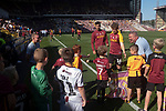 Home played Matt Palmer greeting young fans after the wam-up before Bradford City played Carlisle United in a Skybet League 2 fixture at Valley Parade. The home team were looking to bounce back after being relegated during a disastrous 2018-19 season on and off the pitch. Bradford won the match 3-1, watched by a crowd of 14, 217.