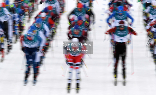 The massed start. Mens 15km Skiathlon. Cross country skiing. Pyeongchang2018 winter Olympics. Alpensia cross country centre. Alpensia. Gangneung. Republic of Korea. 11/02/2018. ~ MANDATORY CREDIT Garry Bowden/SIPPA - NO UNAUTHORISED USE - +44 7837 394578