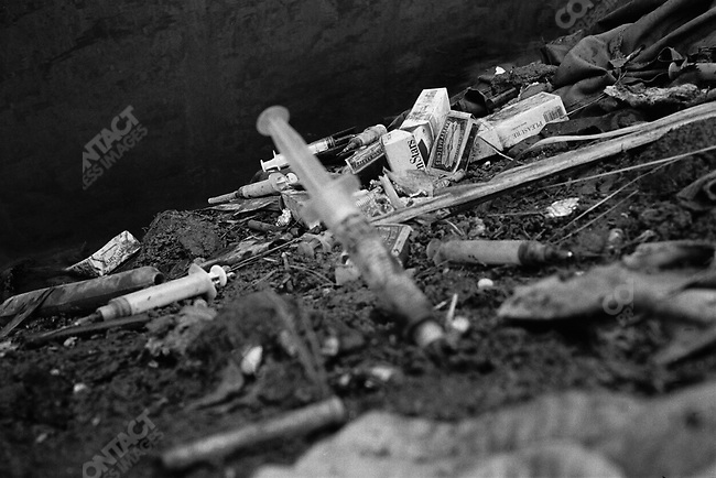 Syringes along  the Kabul River. Kabul, Afghanistan. March 2006