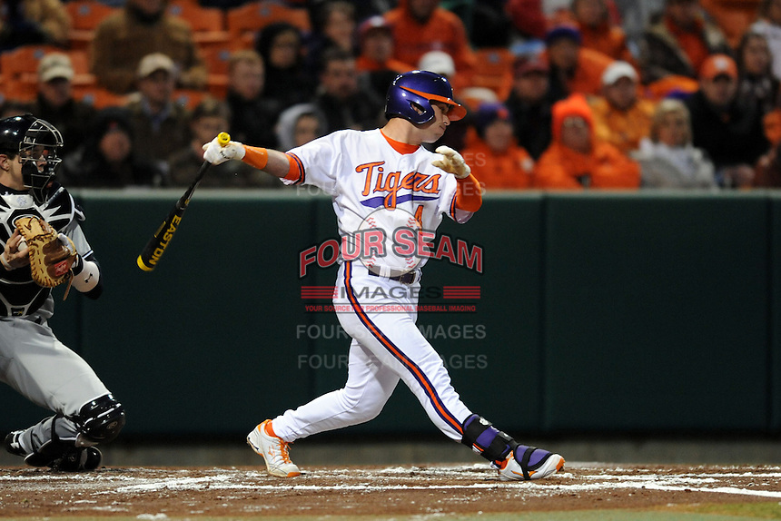 Clemson Tigers center fielder Thomas Brittle #4 swings at a pitch during a game against the South Carolina Gamecocks at Doug Kingsmore Stadium on March 1, 2013 in Clemson, South Carolina. The Gamecocks won 6-0.(Tony Farlow/Four Seam Images).