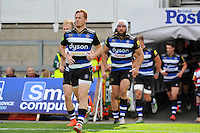 Rory Jennings and the rest of the Bath Rugby team run out onto the field. West Country Challenge Cup match, between Gloucester Rugby and Bath Rugby on September 13, 2015 at the Memorial Stadium in Bristol, England. Photo by: Patrick Khachfe / Onside Images